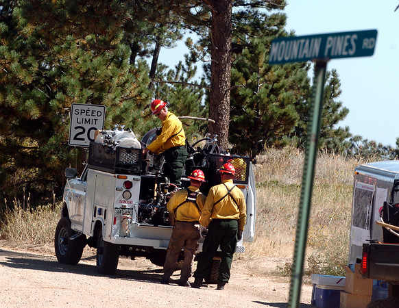 "Fire crews head back to the fire lines from Sugarloaf Rd. and Mountain Pines on September 10, 2010.<br /> For  videos  and photos relating to the fire,  go to  <a href=""http://www.dailycamera.com"">http://www.dailycamera.com</a>.<br /> Cliff Grassmick / September 10, 2010"