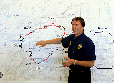 Jim Thomas, Incident Commander, talks about the latest details on Saturday. He expects the fire to be contained by 6 p.m. on September 13, 2010. Fire fighting staff was busy at the Fourmile Mile Fire Incident center on Saturday. For  videos  and photos relating to the fire,  go to www.dailycamera.com. Cliff Grassmick / September 11, 2010