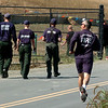 "Firefighters head back to their trucks on Saturday.<br /> Fire fighting staff was busy at the Fourmile Mile Fire Incident center on Saturday.<br /> For  videos  and photos relating to the fire,  go to  <a href=""http://www.dailycamera.com"">http://www.dailycamera.com</a>.<br /> Cliff Grassmick / September 11, 2010"