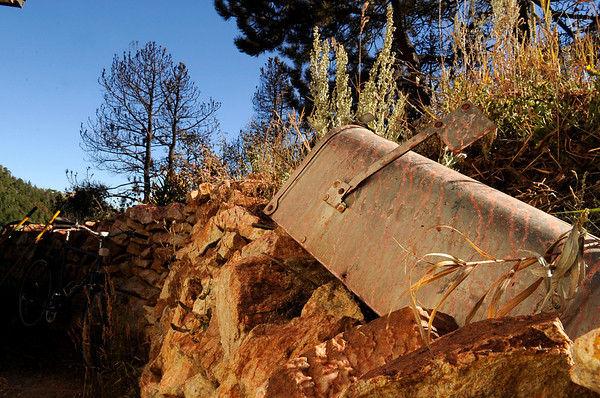 "An old mailbox as well as the stone wall surrounding Dick Cole's house in Gold Hill is covered with red fire retardant on Saturday, Sept. 11. The Fourmile Canyon Fire burned within feet of Cole's home but like many other Gold Hill residents his home was not destroyed.<br /> For video go to  <a href=""http://www.dailycamera.com"">http://www.dailycamera.com</a><br /> Jeremy Papasso/ Camera"