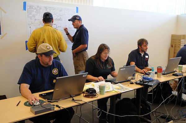 "Fire fighting staff was busy at the Fourmile Mile Fire Incident center on Saturday.<br /> For  videos  and photos relating to the fire,  go to  <a href=""http://www.dailycamera.com"">http://www.dailycamera.com</a>.<br /> Cliff Grassmick / September 11, 2010"