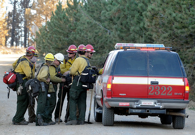 Firefighters get instructions from a Boulder County Rural Fire Department vehicle on Saturday, Sept. 11, just west of Gold Hill. For video go to www.dailycamera.com Jeremy Papasso/ Camera