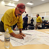 "Tom Smith, Operations Chief, checks the information on the latest map on Saturday.<br /> Fire fighting staff was busy at the Fourmile Mile Fire Incident center on Saturday.<br /> For  videos  and photos relating to the fire,  go to  <a href=""http://www.dailycamera.com"">http://www.dailycamera.com</a>.<br /> Cliff Grassmick / September 11, 2010"