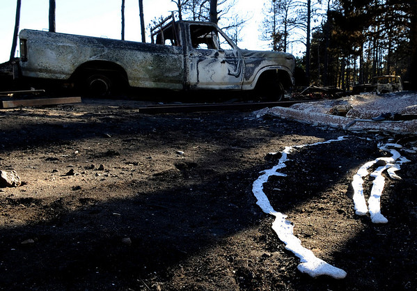 "A melted metal substance lies on the ground in front of a charred truck near the Colorado Mountain Ranch on Saturday, Sept. 11, on Gold Hill Road.<br /> For video go to  <a href=""http://www.dailycamera.com"">http://www.dailycamera.com</a><br /> Jeremy Papasso/ Camera"