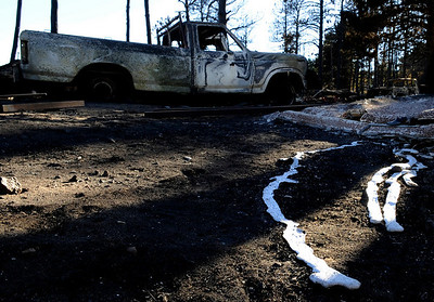 A melted metal substance lies on the ground in front of a charred truck near the Colorado Mountain Ranch on Saturday, Sept. 11, on Gold Hill Road. For video go to www.dailycamera.com Jeremy Papasso/ Camera