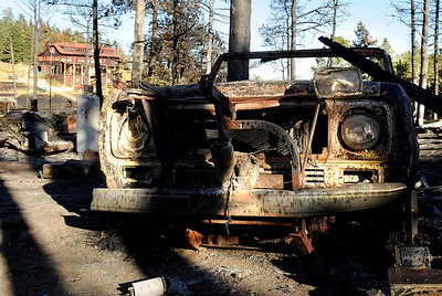 A destroyed truck sits in the blackened trees near the Colorado Mountain Ranch, house in back, on Gold Hill Road on Saturday, Sept. 11. For video go to www.dailycamera.com Jeremy Papasso/ Camera