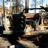 "A destroyed truck sits in the blackened trees near the Colorado Mountain Ranch, house in back, on Gold Hill Road on Saturday, Sept. 11.<br /> For video go to  <a href=""http://www.dailycamera.com"">http://www.dailycamera.com</a><br /> Jeremy Papasso/ Camera"