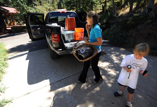 "Connie Fisher and her son, Max,  move some of their belongings back to their home on Tall Pine Road on Saturday.<br /> Residents in the Boulder Heights area of the Fourmile Fire move back, check on their houses on September 11, 2010.<br /> For  videos  and photos relating to the fire,  go to  <a href=""http://www.dailycamera.com"">http://www.dailycamera.com</a>.<br /> Cliff Grassmick / September 11, 2010"