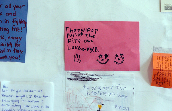 "There is a ""thank you"" board in the Incident Command center with cards and letters from the public.<br /> Fire fighting staff was busy at the Fourmile Mile Fire Incident center on Saturday.<br /> For  videos  and photos relating to the fire,  go to  <a href=""http://www.dailycamera.com"">http://www.dailycamera.com</a>.<br /> Cliff Grassmick / September 11, 2010"