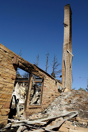 "The chimney of a burned home still stands on Sunshine Canyon Drive on Saturday, Sept. 11.<br /> For video go to  <a href=""http://www.dailycamera.com"">http://www.dailycamera.com</a><br /> Jeremy Papasso/ Camera"