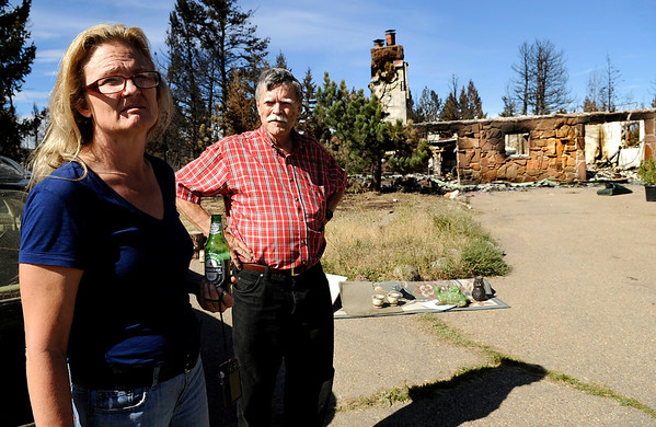 "Elizabeth Wallace and her ex-husband John Spelz wait for family members to arrive at what is left of Wallace's home on Sunday, Sept. 12, on Mountain King Road in Boulder County. Wallace was able to evacuate with her family and some paintings before the Fourmile Canyon Fire destroyed her home.<br /> For video and photo gallery go to  <a href=""http://www.dailycamera.com"">http://www.dailycamera.com</a><br /> Jeremy Papasso/ Camera"