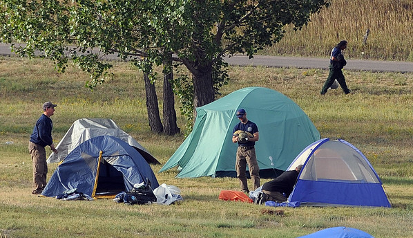 "Firefighters begin to clean up their camp site on Sunday September 12, 2010 at the Boulder Reservoir.<br /> For  videos  and photos relating to the fire,  go to  <a href=""http://www.dailycamera.com"">http://www.dailycamera.com</a>.<br /> Cliff Grassmick / September 12, 2010"