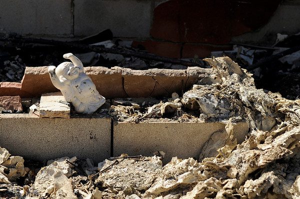 "A Buddha statue sits in the rubble of a burned home on Sunday, Sept. 12, at the Wallace residence on Mountain King Road in Boulder County.<br /> For video and photo gallery go to  <a href=""http://www.dailycamera.com"">http://www.dailycamera.com</a><br /> Jeremy Papasso/ Camera"