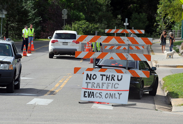 "Roads were closed around the Boulder County Justice Center while evacuees picked up passes.<br /> Fourmile Fire evacuees get green passes to allow them to return to their homes when their areas are open.<br /> For  videos  and photos relating to the fire,  go to  <a href=""http://www.dailycamera.com"">http://www.dailycamera.com</a>.<br /> Cliff Grassmick / September 12, 2010"