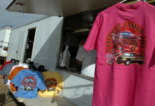 "A company from Reno, NV, sells T-shirts to firefighters outside the Boulder Reservoir that feature the Fourmile Fire.<br /> For  videos  and photos relating to the fire,  go to  <a href=""http://www.dailycamera.com"">http://www.dailycamera.com</a>.<br /> Cliff Grassmick / September 12, 2010"