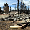 This is all that is left of a home on Mountain Pines Road on Sunday, Sept. 12, in Boulder County. Several houses in the area were destroyed by the Fourmile Canyon Fire, however some homes were miraculously unaffected.<br /> Jeremy Papasso/ Camera
