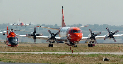 An airtanker lands while another taxies to the US Forest Service Airtanker base at Rocky Mountain Metro Airport to be filled with fire retardant to fight the Four Mile fire in Boulder County on Tuesday.   September 7, 2010 staff photo/David R. Jennings