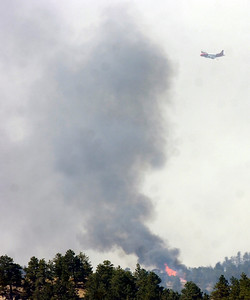 A slurry bomber works against the fire on Tuesday afternoon as seen from Flagstaff Mountain Photo by Paul Aiken / The Camera