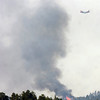 A slurry bomber works against the fire on Tuesday afternoon as seen from Flagstaff Mountain<br /> Photo by Paul Aiken / The Camera