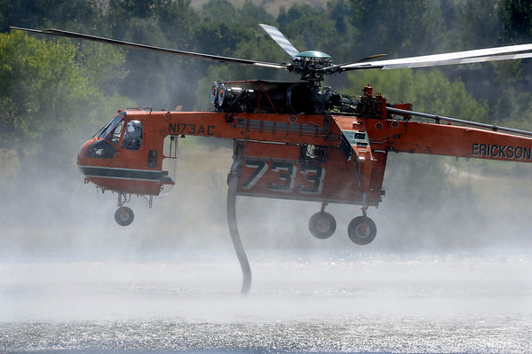 4MILETUES<br /> A helicopter draws water out of Wonderland Lake while fighting the Fourmile Canyon Fire on Tuesday. <br /> Photo by Marty Caivano/Camera/Sept.7, 2010