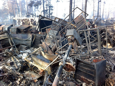 Multiple agencies responded to a wildland fire in Emerson Gulch near Gold Hill. Crews worked through the night doing initial attack in homes in the Gold Hill area as well as Colorado Mountain Ranch. This morning the scene was one of burned homes, structures and cars. (Eric Peter Abramson, Special to The Denver Post)
