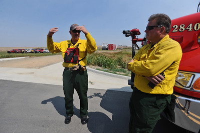 4MILETUES Don Cole, left, and Derek Westmoreland, from the Hygiene Fire Protection District, talk while waiting for an assignment at the Boulder County Fire Training Center on Tuesday.  Photo by Marty Caivano/Camera/Sept.7, 2010