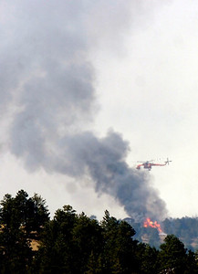 A helicopter works against the fire on Tuesday afternoon as seen from Flagstaff Mountain Photo by Paul Aiken / The Camera