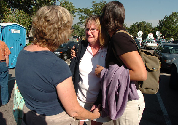 Nancy Engellenner,  is comforted by Dee Spencer, at left and Jean Gatza in the parking lot of the Boulder County Justice Center. Engellenner, who lives in Sunshine Canyon believes her house was destroyed in the fire. According to evacuees witnesses saw Spencer's house being destroyed by fire.<br /> Paul Aiken / The Camera