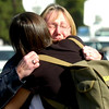 Nancy Engellenner,  gets a hug from Jean Gatza (with back to camera) in the parking lot of the Boulder County Justice Center. Engellenner, who lives in Sunshine Canyon believes her house was destroyed in the fire.  Paul Aiken / The Camera