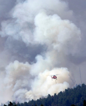 A helicopter works against the fire on Tuesday afternoon as seen from Flagstaff Mountain<br /> Photo by Paul Aiken / The Camera