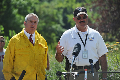 4MILETUES Colorado governor Bill Ritter, left, and Boulder County Sheriff Joe Pelle, right, speak to the press on Tuesday after touring the Fourmile Canyon Fire. Photo by Marty Caivano/Camera/Sept.7, 2010
