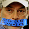 20121213_OIL_AND_GAS_3595.jpg Rod Brueske, silently protests outside the meeting room, Thursday, Dec. 13, 2012, at the Boulder County Courthouse.<br /> (Matthew Jonas/Times-Call)