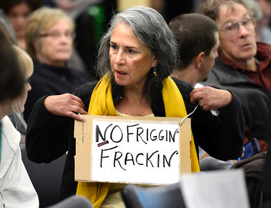 "20121213_OIL_AND_GAS_8559.jpg Elizabeth Allen, of Boulder, wears a ""No Friggin' Frackin'"" sign while waiting for the meeting to begin, Thursday, Dec. 13, 2012, at the Boulder County Courthouse. (Jeremy Papasso/Daily Camera)"