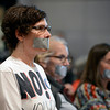 "Fracking002.JPG Anti-fracking supporter Diana Devine listens with duck tape over her mouth during meeting on fracking on Thursday, Dec. 13, at the County Courthouse on Pearl Street in Boulder. For more photos and video of the tracking protest go to  <a href=""http://www.dailycamera.com"">http://www.dailycamera.com</a><br /> Jeremy Papasso/ Camera"