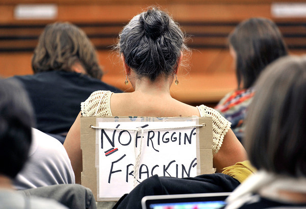 "20121213_OIL_AND_GAS_014.jpg Elizabeth Allen, of Boulder, wears a ""No Friggin' Frackin'"" sign while waiting for the meeting to begin, Thursday, Dec. 13, 2012, at the Boulder County Courthouse.<br /> (Matthew Jonas/Times-Call)"