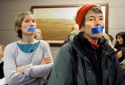 OIL_AND_GAS_1755.jpg From left: Marion Frebourg, of Longmont, and Liza Carlson, of Boulder, silently protest outside the meeting room, Thursday, Dec. 13, 2012, at the Boulder County Courthouse. (Jeremy Papasso/Daily Camera)