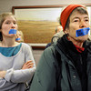 OIL_AND_GAS_1755.jpg From left: Marion Frebourg, of Longmont, and Liza Carlson, of Boulder, silently protest outside the meeting room, Thursday, Dec. 13, 2012, at the Boulder County Courthouse.<br /> (Jeremy Papasso/Daily Camera)