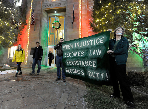 """Fracking003.JPG Jennifer Murnan, of Boulder, right, and a man, who asked not to be identified, hold an anti-fracking sign after meeting on fracking on Thursday, Dec. 13, at the County Courthouse on Pearl Street in Boulder. For more photos and video of the tracking protest go to  <a href=""""http://www.dailycamera.com"""">http://www.dailycamera.com</a><br /> Jeremy Papasso/ Camera"""