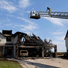 20110705_FIRE_FREDERICK_03.JPG Firefighters investigate a fire that severely damaged 4895 and 4897 Wren Court in Frederick on Tuesday, July 5, 2011. Frederick-Firestone Protection District responded shortly before midnight Monday to a call of a structure fire. (Richard M. Hackett/Times-Call)