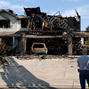 20110705_FIRE_FREDERICK_02.JPG Firefighters investigate a fire that severely damaged 4895 and 4897 Wren Court in Frederick on Tuesday, July 5, 2011. Frederick-Firestone Protection District responded shortly before midnight Monday to a call of a structure fire. (Richard M. Hackett/Times-Call)