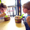 "Trevor Fox, 7, right, takes a break from eating because of his ""brain freeze: while Ian Capdevielle, 9 at left tucks into his yogurt at Aspen Leaf Yogurt in the Table Mesa Shopping Center in Boulder on Tuesday.<br /> Photo by Paul Aiken / The Camera / May 3, 2011"
