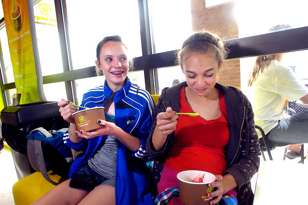 Kayla Steinmetz, left, and Kaileigh Mora, both 13, enjoy frozen yogurt at Aspen Leaf Yogurt in the Table Mesa Shopping Center in Boulder on Tuesday.<br /> Photo by Paul Aiken / The Camera / May 3, 2011