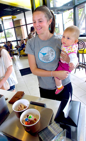 Zoe McCaffrey and her daughter Liliana wait to pay for their frozen yogurt at Aspen Leaf Yogurt in the Table Mesa Shopping Center in Boulder on Tuesday.<br /> Photo by Paul Aiken / The Camera / May 3, 2011