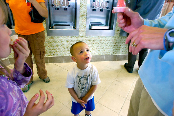 Robbie Kubitschek, 3, pleads with his mother Amy for another sample tast at Aspen Leaf Yogurt in the Table Mesa Shopping Center in Boulder on Tuesday. His sister Lia, 7, is at left.<br /> Photo by Paul Aiken / The Camera / May 3, 2011