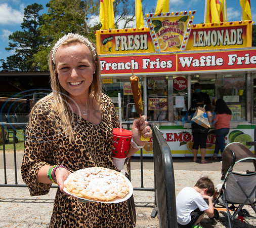 Caroline Artmire bought a funnel cake and corn dog at The Fair Food Drive-In, a special event at the East Texas State Fair fairgrounds open from 11:00 am to 8:00 pm on Thursday, June 4th through Sunday, June 7th. The Fair Food Drive-In features East Texas based concessionaires McKinney Concessions and Corky Westmorland Concessions alongside Wonderstick Ice Cream presenting a limited menu of fair food favorites for visitors to take to-go.