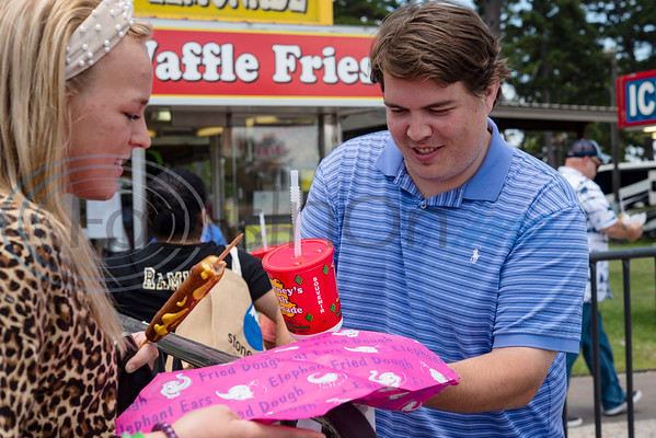 Caroline Artmire and Hunter Bryant open a funnel cake at The Fair Food Drive-In, a special event at the East Texas State Fair fairgrounds open from 11:00 am to 8:00 pm on Thursday, June 4th through Sunday, June 7th. The Fair Food Drive-In features East Texas based concessionaires McKinney Concessions and Corky Westmorland Concessions alongside Wonderstick Ice Cream presenting a limited menu of fair food favorites for visitors to take to-go.