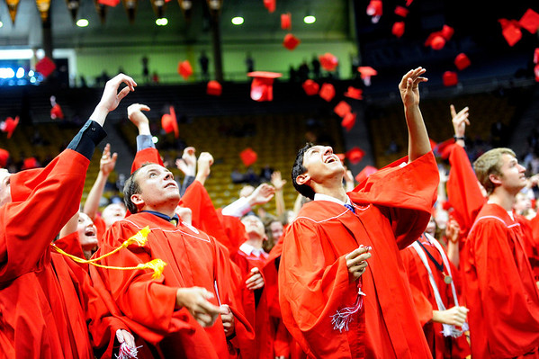 FVGRAD<br /> Casey Barton, left, and Brayden Bean toss their caps at the end of the Fairview High School commencement at the Coors Event Center on Sunday.<br /> <br /> Photo by Marty Caivano/May 22, 2011