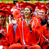 FVGRAD<br /> Left to right, Nina Allan, Joseph Aicher and Mariya Agarkova applaud a speech made by faculty speaker Daniel Niedringhaus during the Fairview High School commencement at the Coors Event Center on Sunday.<br /> <br /> Photo by Marty Caivano/May 22, 2011