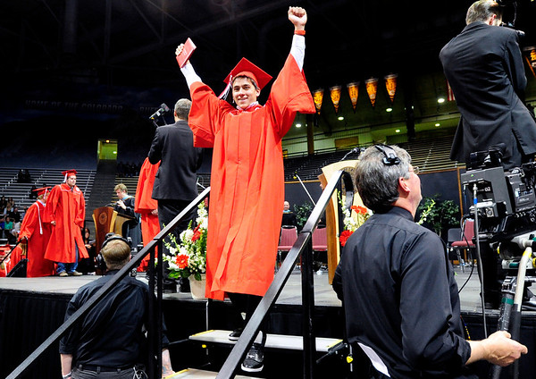 FVGRAD<br /> Stephen Fung-A-Fat celebrates after receiving his diploma during the Fairview High School commencement at the Coors Event Center on Sunday.<br /> <br /> Photo by Marty Caivano/May 22, 2011