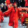 """FVGRAD<br /> Ashley Parada high-fives her classmates after receiving her diploma at Fairview High School's graduation at the Coors Event Center on Sunday. For a video about the graduation, see  <a href=""""http://www.dailycamera.com"""">http://www.dailycamera.com</a>.<br /> <br /> Photo by Marty Caivano/May 22, 2011"""